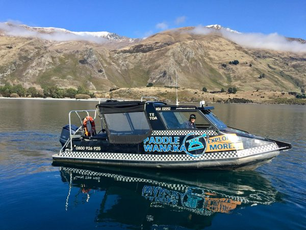 Water taxi on glassy lake wanaka